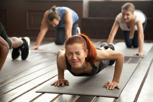 Woman in a work out with a headache