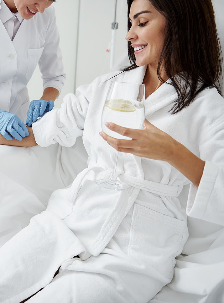 Woman getting IV therapy