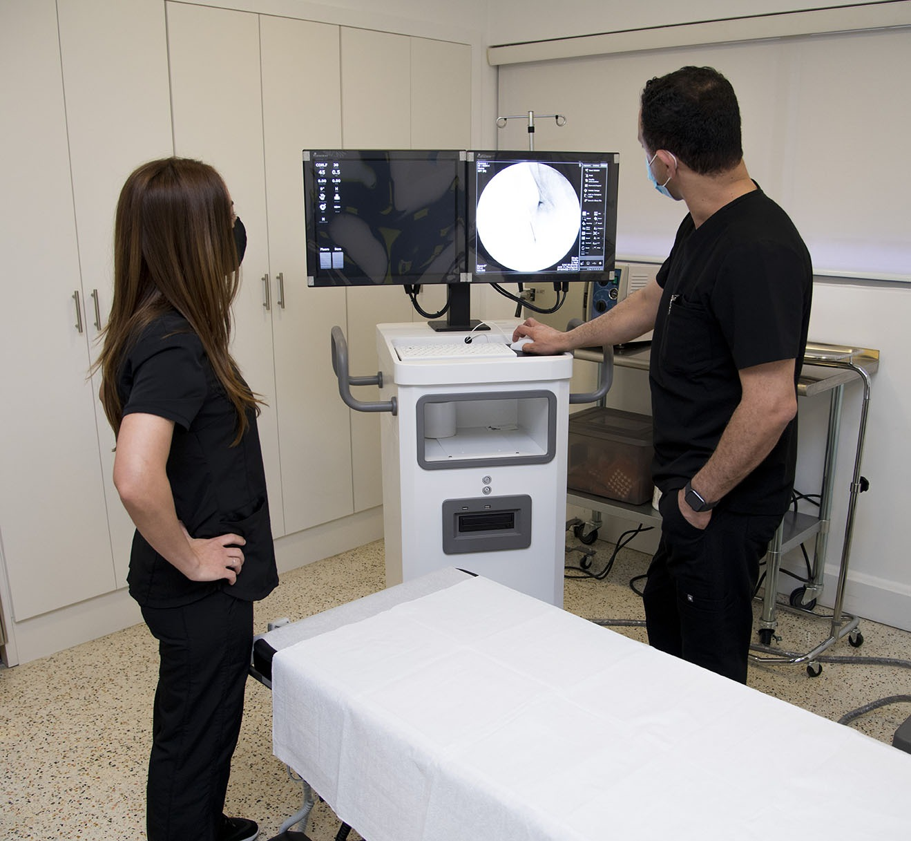 Two physicians looking at scan in a clinical setting